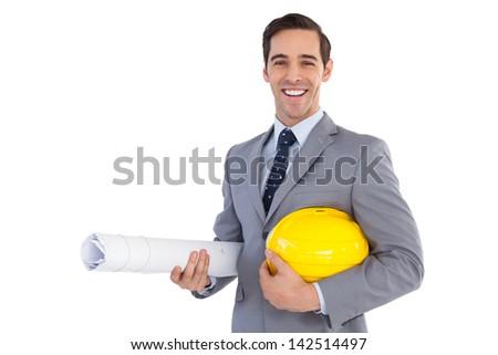 Happy architect holding plans and hard hat on white background - stock photo
