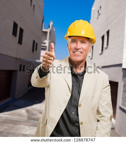 Happy Architect Showing Thumb Up Sign, outdoor - stock photo