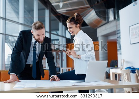 Happy architects workin on new business project - stock photo