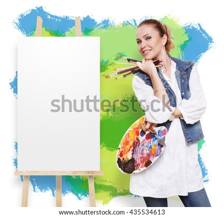 Happy artist. Woman artist with art tools. Female painter with brushes and palette. Empty canvas at easel at colorful wall with copy space. Fine art. Art classes for adults, education concept. - stock photo