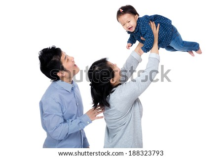 Happy asia family with baby girl throw up - stock photo