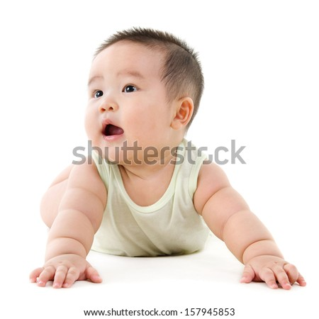 Happy Asian baby boy looking up and smiling. Full body crawling on floor, isolated on white background. - stock photo