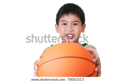 happy asian boy holding a ball - stock photo