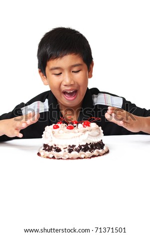 Happy asian boy with delicious cake - stock photo