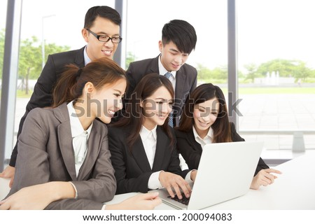 happy asian business team working in office - stock photo