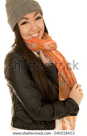 Happy Asian Caucasian teen wearing scarf and beanie - stock photo