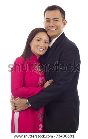 Happy Asian couple embracing isolated over white background - stock photo