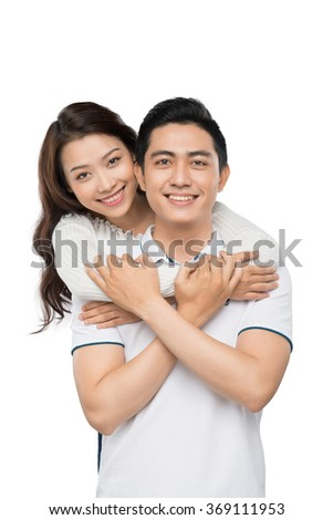 Happy asian couple isolated on white background. Cheerful young couple standing. Portrait of smiling couple embracing.  - stock photo