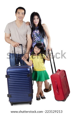 Happy asian family carrying luggage and ready to holiday, isolated over white background - stock photo