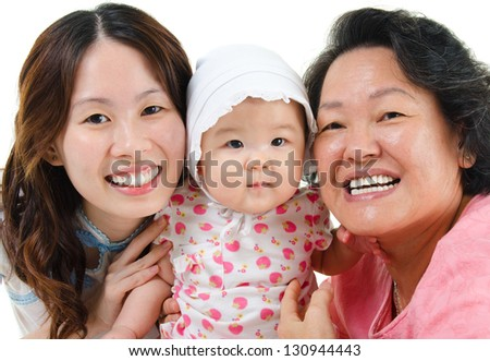 Happy Asian family isolated on white. Three generations Asian family, grandmother, mother and granddaughter. - stock photo
