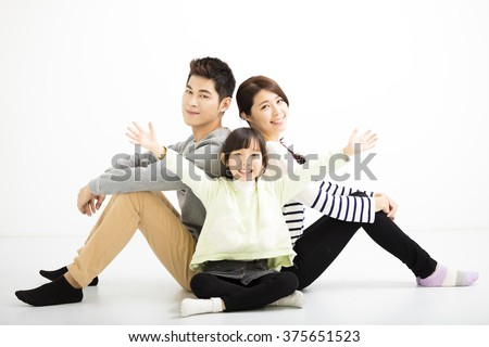 happy asian family sitting together - stock photo