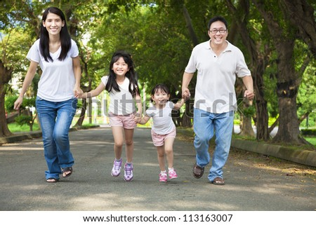 happy asian family walking on the road - stock photo