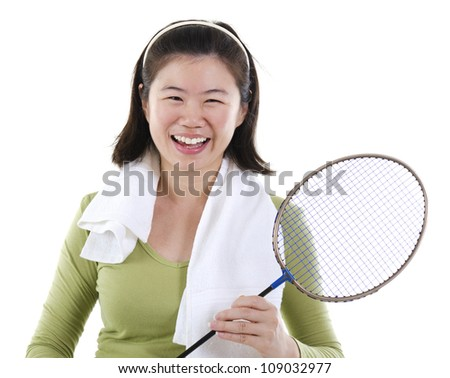Happy Asian female holding badminton racket over white background - stock photo