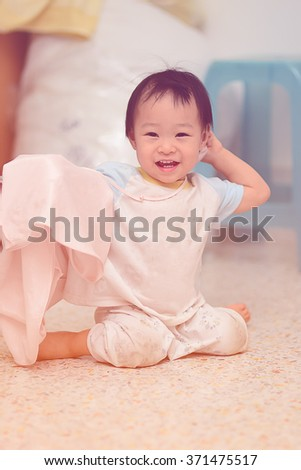 Happy Asian girl at home. - stock photo