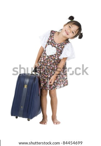happy Asian girl carrying her heavy luggage over white background - stock photo