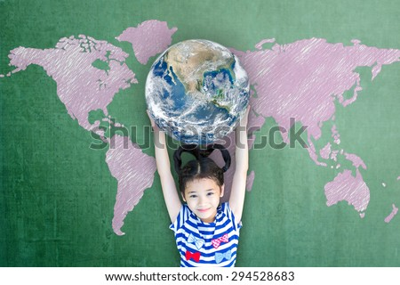 Happy Asian girl kid holding globe over green chalkboard with pink world map background: Little child raising hands carrying planet in front of blackboard: Elements of this image furnished by NASA   - stock photo