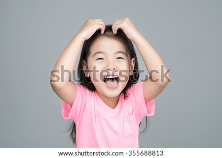 Happy Asian girl smile on her face - stock photo