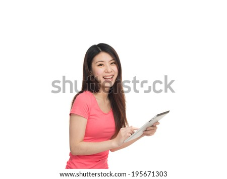 Happy asian girl using her tablet tapping on the screen. Isolated on white. - stock photo