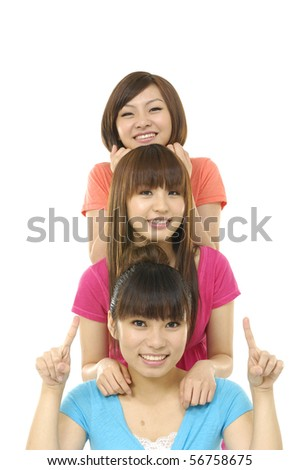 happy asian Group of students smiles at the camera - stock photo