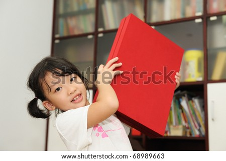 Happy asian kid with her gift box - stock photo