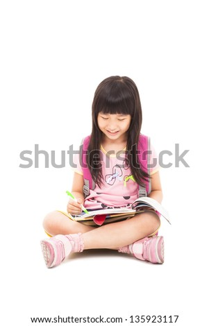 happy asian little girl sitting and reading a book - stock photo