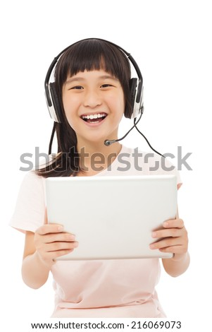 happy asian little student girl holding a tablet with earphone  - stock photo