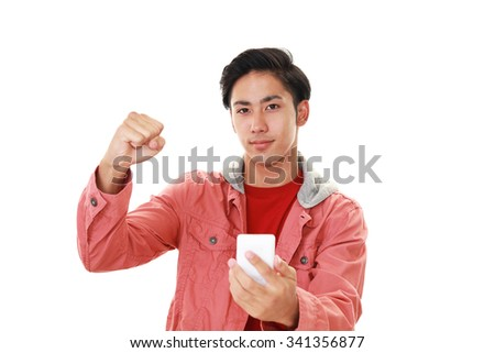 Happy Asian man holding a smart phone 	 - stock photo