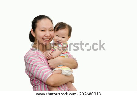 Happy Asian mother holding adorable child baby girl - stock photo