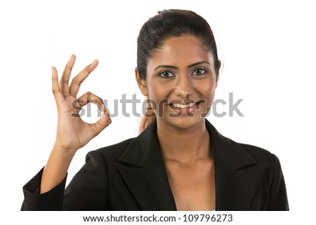 Happy Asian woman doing OK symbol with her hand. Isolated on white background. - stock photo