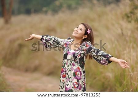 happy asian woman enjoying nature, thailand - stock photo