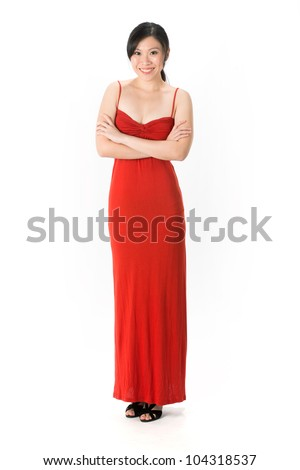 Happy Asian woman in red dress ready for night out. Isolated on white. - stock photo