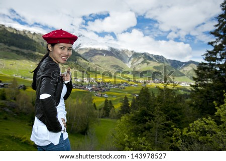 happy asian woman in the alps - stock photo