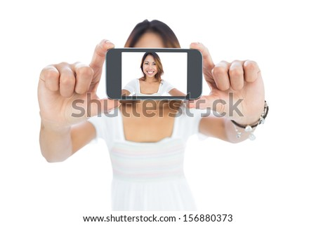 Happy asian woman taking a selfie using her smartphone  - stock photo