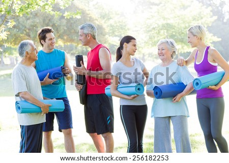 Happy athletic group talking on a sunny day - stock photo