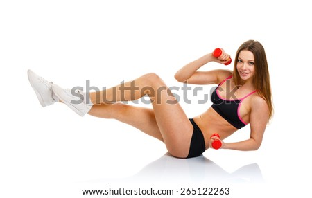 Happy athletic woman with dumbbells doing sport exercise, isolated on white background - stock photo
