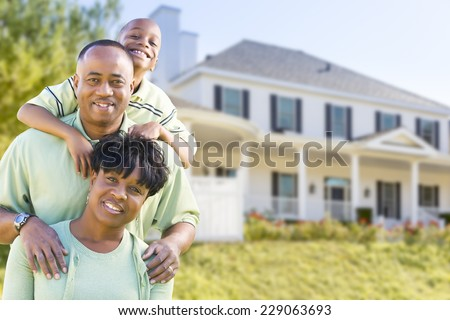Happy Attractive African American Family in Front of Beautiful House. - stock photo