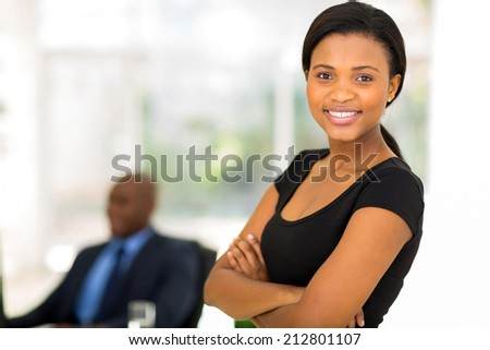 happy attractive african businesswoman in office - stock photo