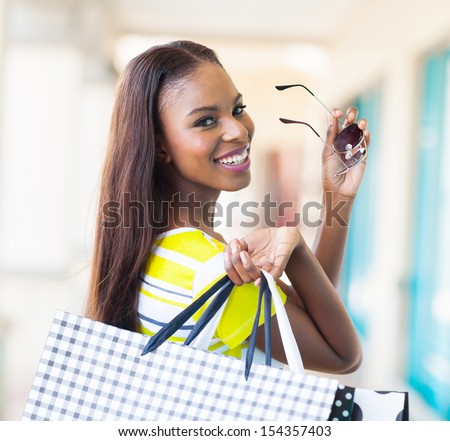 happy attractive african shopper in shopping mall - stock photo