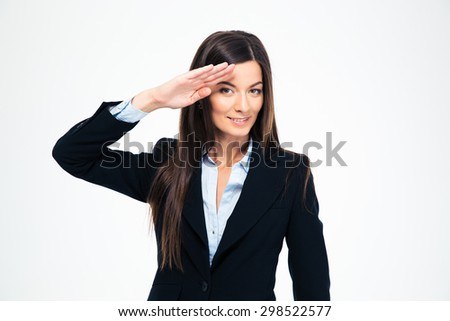 Happy attractive businesswoman saluting isolated on a white background. Looking at camera - stock photo