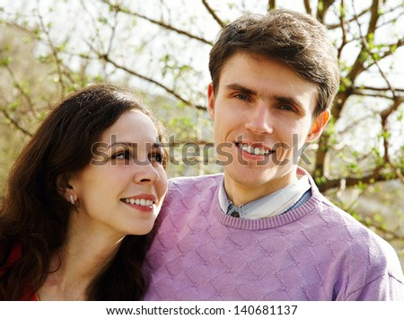 Happy attractive couple together outdoor - stock photo