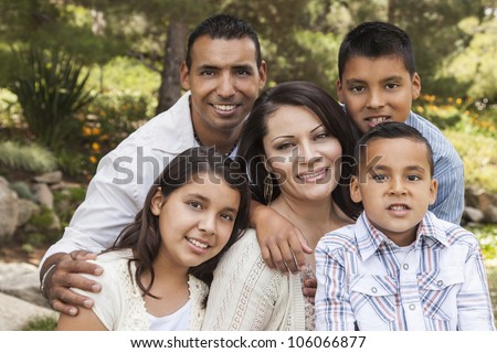 Happy Attractive Hispanic Family Portrait Outdoors In the Park. - stock photo