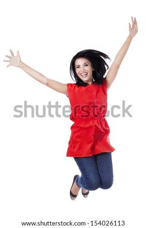 Happy attractive woman jumping in the air - isolated over a white background  - stock photo