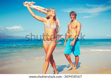 Happy Attractive Young Couple on Tropical Beach - stock photo