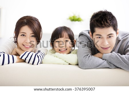 Happy Attractive Young  Family and little girl - stock photo