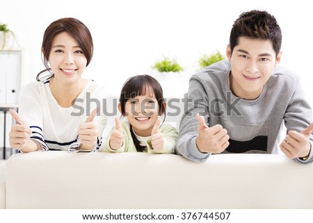 Happy Attractive Young  Family with thumbs up - stock photo