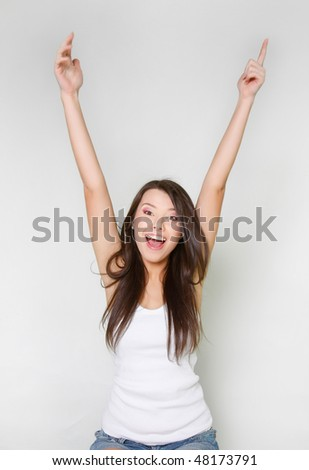 happy attractive young girl with her hands up - stock photo