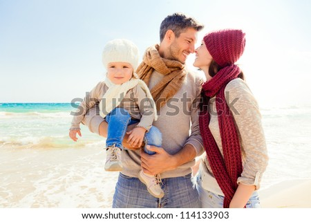 happy autumn fall family on coast enjoying togetherness - stock photo