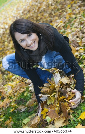 Happy Autumn - smiling girl in the park. - stock photo