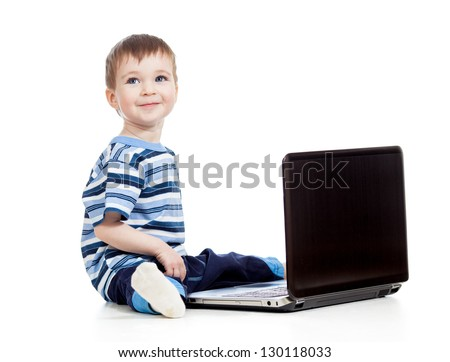 happy baby boy using a laptop over white background - stock photo