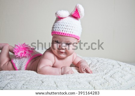 Happy baby dressed in Easter bunny. - stock photo